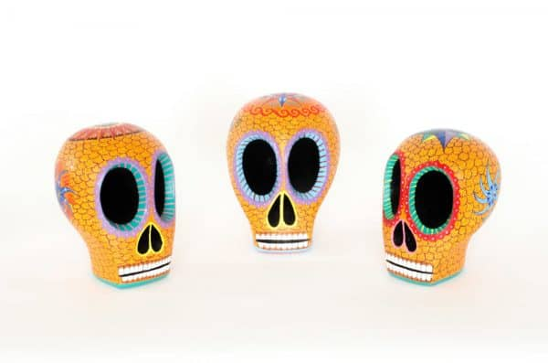 Beautiful hand-carved, hand painted colourful Mexican skulls, known as Calaveras, for Day of the Dead or Halloween. Extraordinary Mexican art from MexArt in London, UK