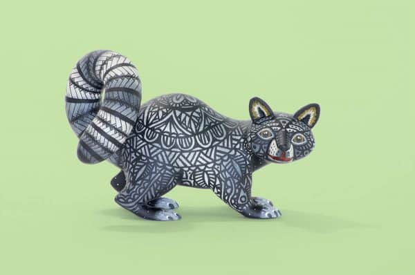 A black and white racoon with captivating eyes by young artist Giovanni Melchor. Extraordinary Mexican art from MexArt, London UK.