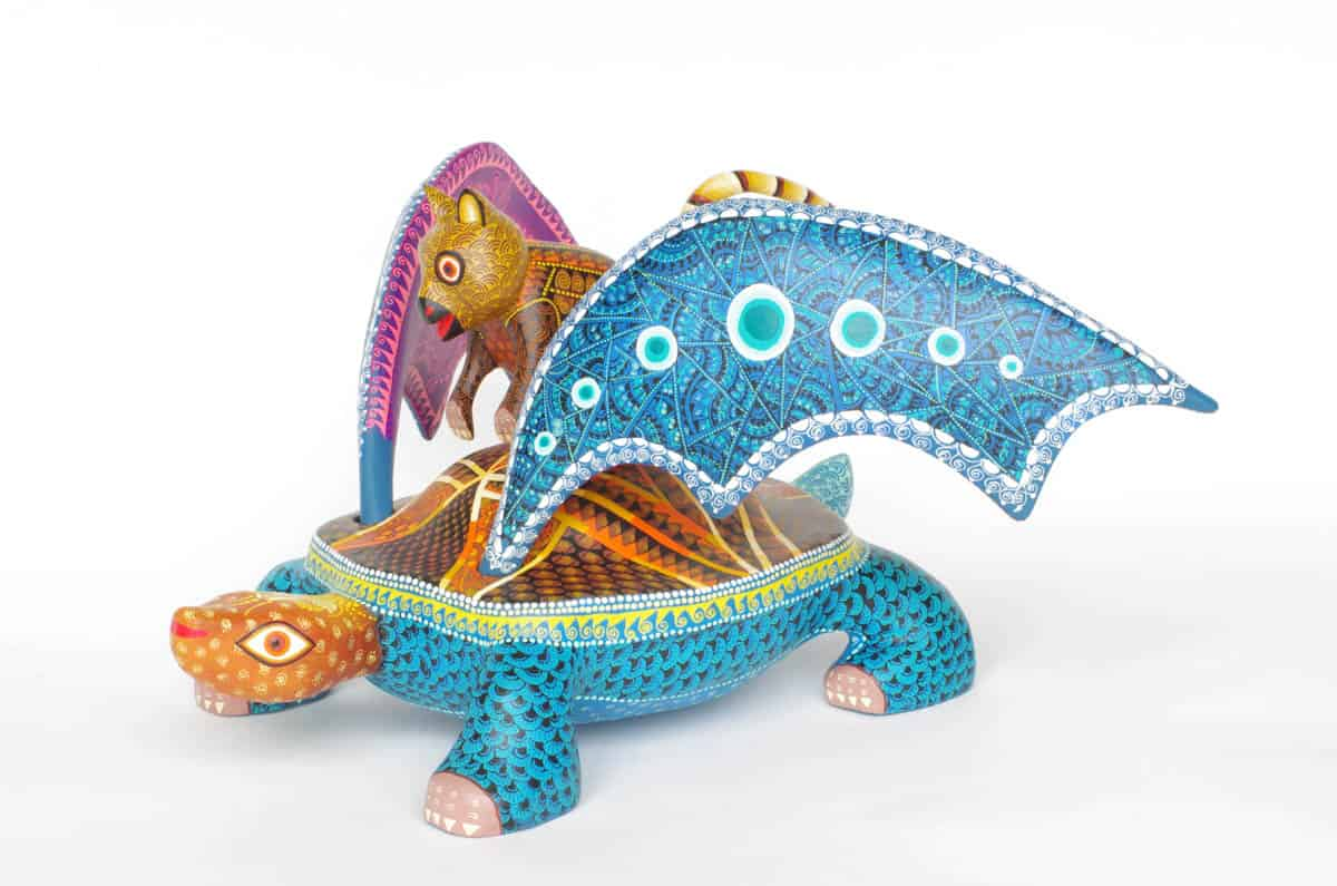 Very imaginative made under comission with the shape of a turtle with wings and a quokka riding on its back.