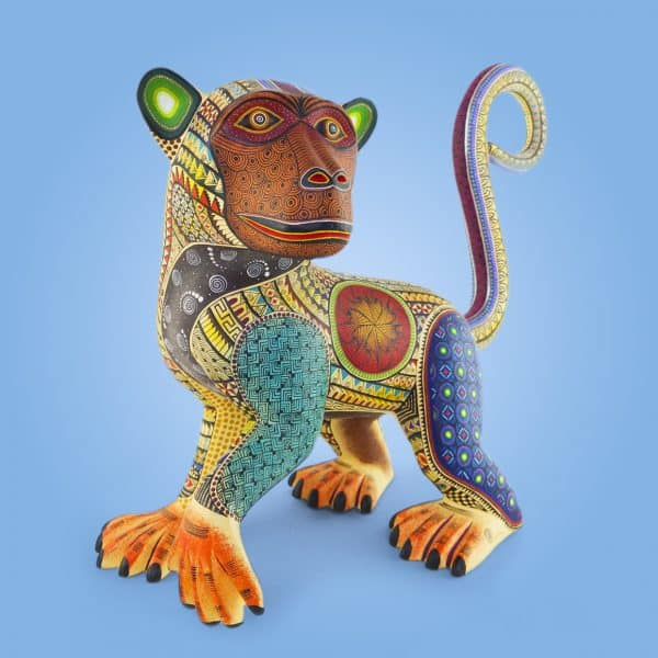Hand carved, hand painted alebrije in the shape of a monkey