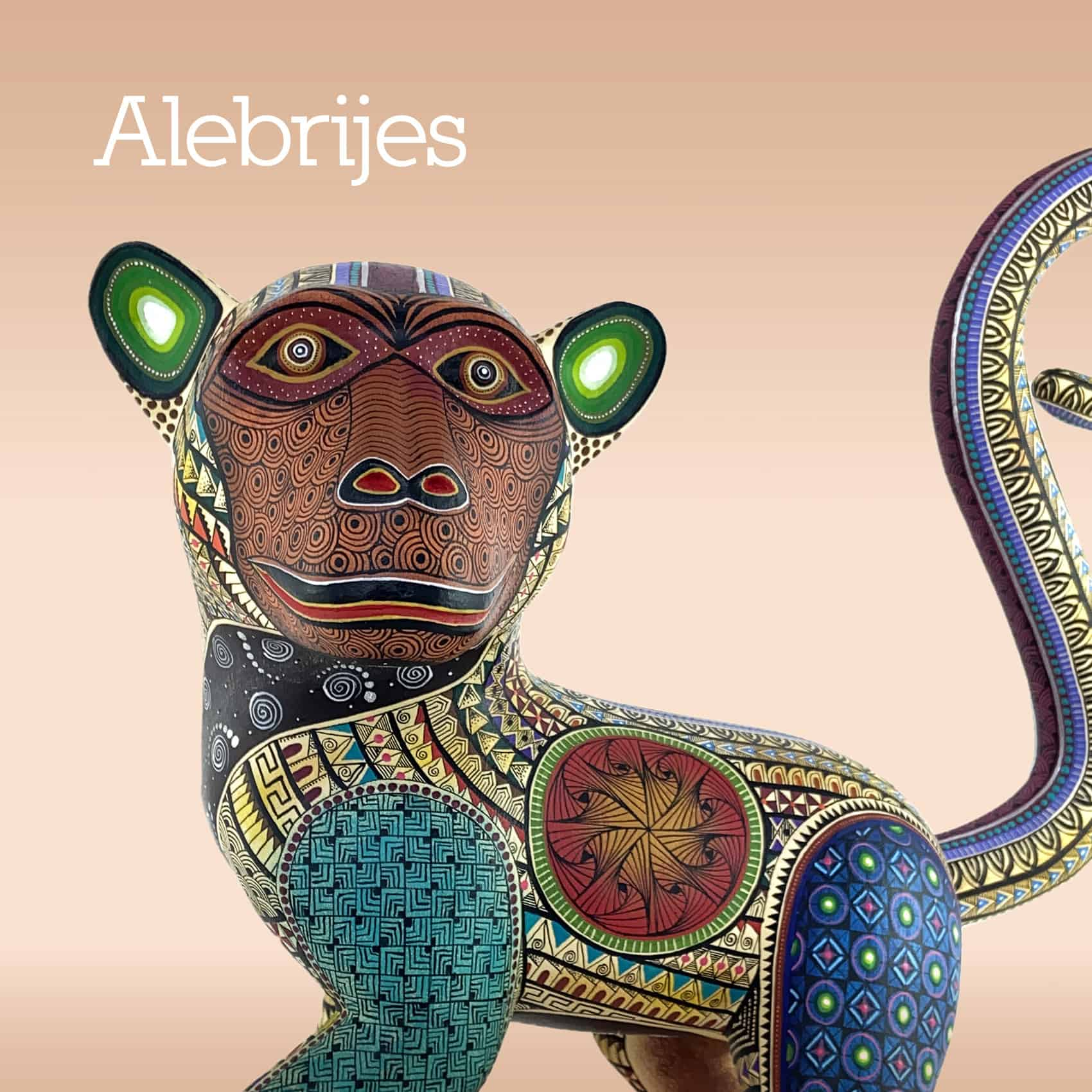 hand carved, hand painted monkey alebrije with a terracota colour face
