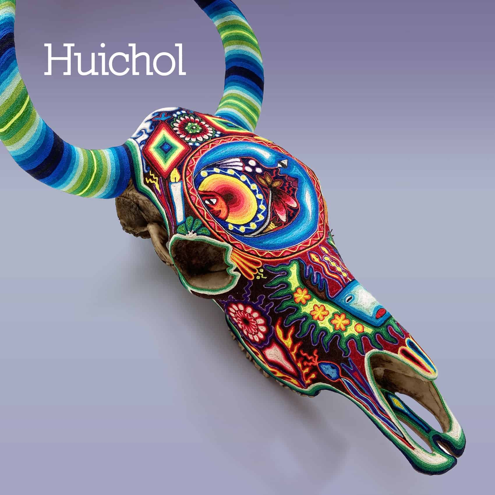a Mexican Huichol resin cow skull decorated with colourful yarn